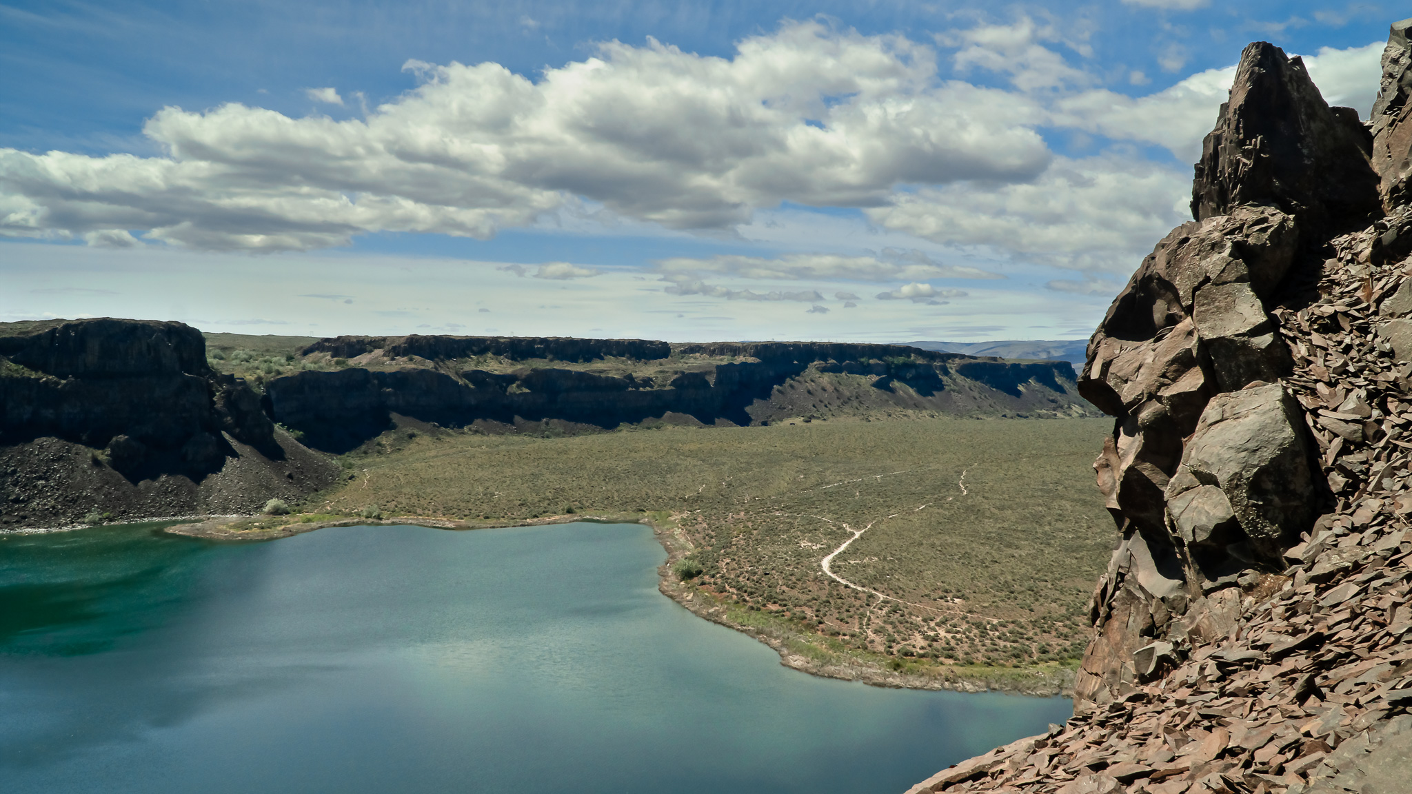 Having hiked up to the saddle between coulees we were able to look down at Dusty Lakes.